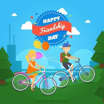 Przyjaciele z rowerami w tle krajobrazu