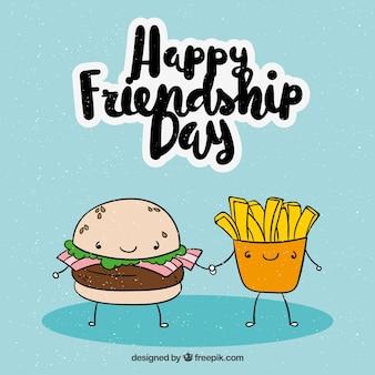 Przyjaźń dzień tła z burger i wiórów