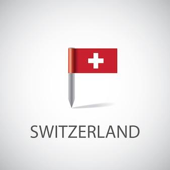 Przypinka z flagą szwajcarii, na białym tle na jasnym tle
