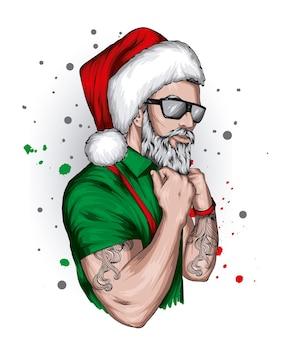 Przystojny facet w stylowych ubraniach i czapce świętego mikołaja na boże narodzenie i nowy rok