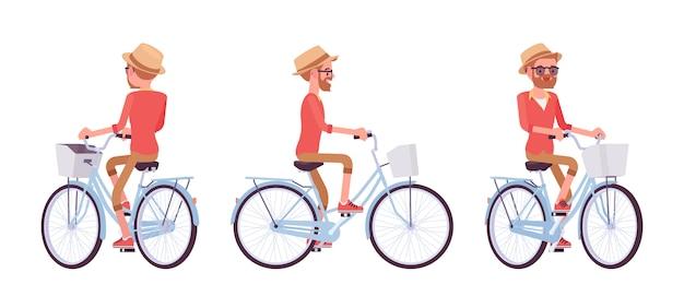 Przystojny mężczyzna w średnim wieku, jazda na rowerze