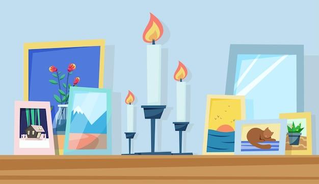 Przytulna półka ze świecami i ramkami na zdjęcia