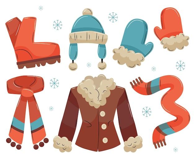 Przytulna zimowa kolekcja ubrań i niezbędnych artykułów