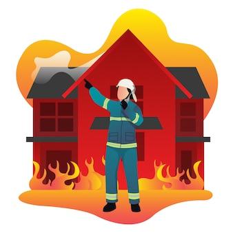 Przywódca straży pożarnej kieruje podwładnymi, gdy ogień pali klasyczny dom