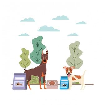 Psy z miską i karmą dla zwierząt domowych na krajobrazie