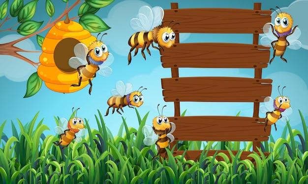 Pszczoła lata i drewniany podpisujemy wewnątrz ogród