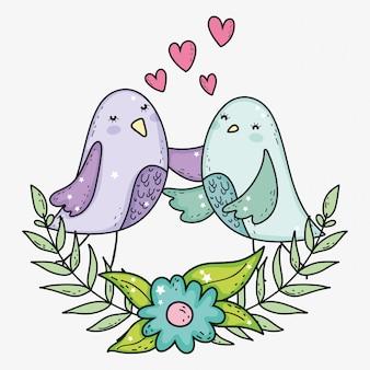 Ptaki dobierają się z sercami i gałąź opuszczają z kwiatem