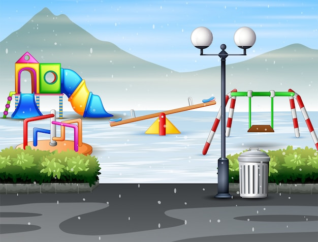 Publiczny park w mieście z placem zabaw dla dzieci w zimie