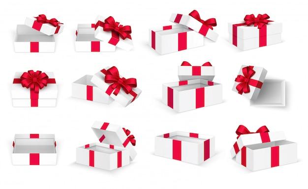 Pudełka na prezenty. białe otwarte puste pudełko z czerwoną kokardą i wstążkami. szablon dzień bożego narodzenia i walentynki