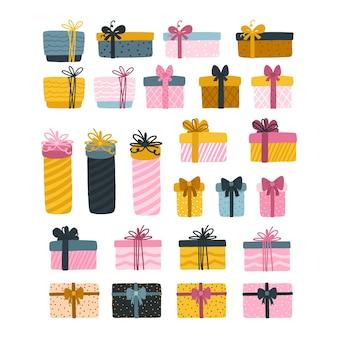 Pudełka na prezenty z wstążkami i kokardkami w dziecinnej kreskówce ręcznie rysowanej. na boże narodzenie