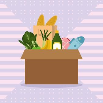 Pudełko z artykułami spożywczymi i warzywami