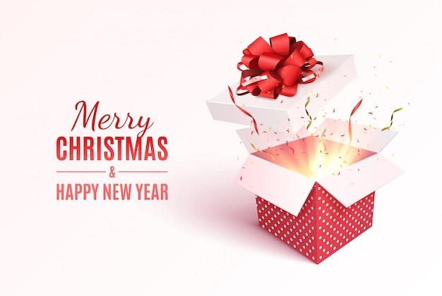 Pudełko z czerwoną wstążką i kokardą. wesołych świąt i szczęśliwego nowego roku kartkę z życzeniami.