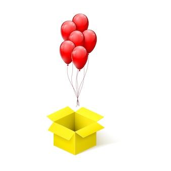 Pudełko z niespodzianką. balony latające z otwartego żółtego pola