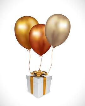 Pudełko z złoty balon na białym tle