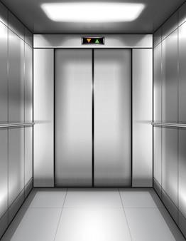 Pusta kabina windy z zamkniętymi drzwiami w środku