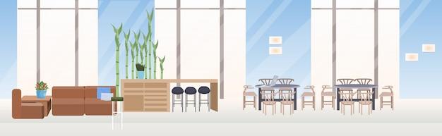 Pusta kawiarnia bez ludzi z kreatywnym kooperatywnym obszarem przestrzeni wewnętrznej poziomym sztandarem