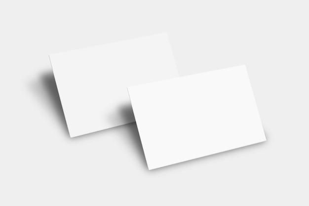 Pusta makieta wizytówki w białym odcieniu z widokiem z przodu iz tyłu