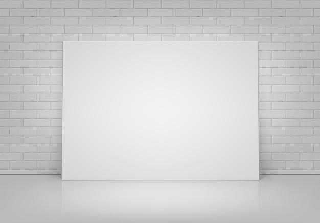Pusta pusta biała makieta plakat ramka na zdjęcia stojąca na podłodze z widokiem z przodu ściany z cegły