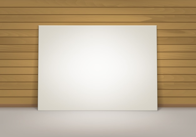 Pusta pusta biała makieta plakatowa ramka na zdjęcia stojąca na podłodze z brązową drewnianą ścianą sienna widok z przodu