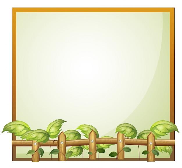 Pusta ramka z drewnianym ogrodzeniem i roślinami winorośli