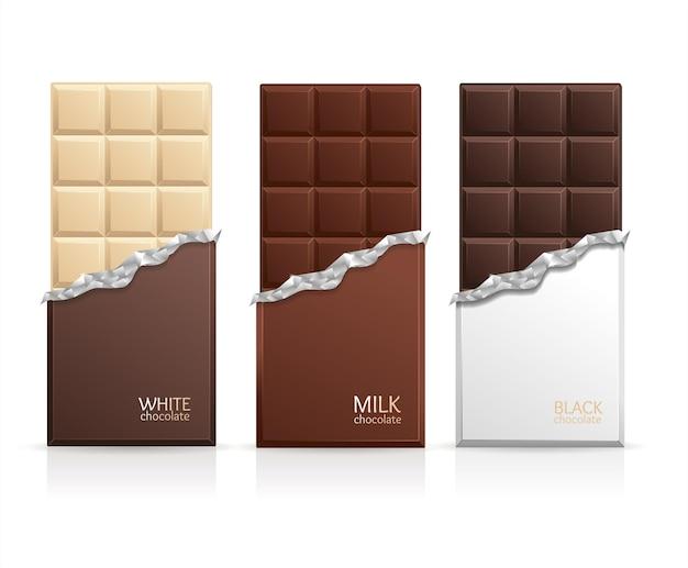 Pusta tabliczka czekolady — mleczna, biała i ciemna.