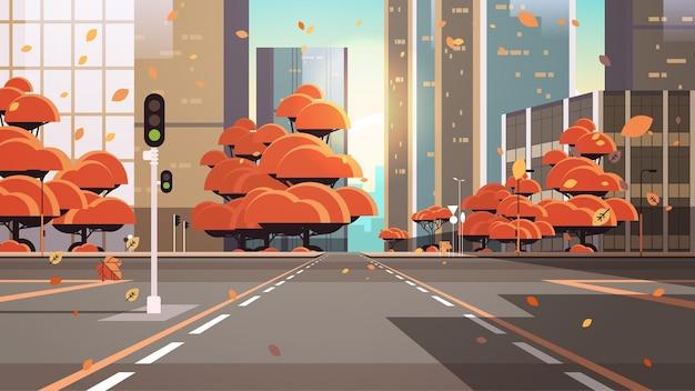 Pusta ulica z przejściem dla pieszych budynki miejskie panoramę nowoczesnej architektury jesienny pejzaż miejski