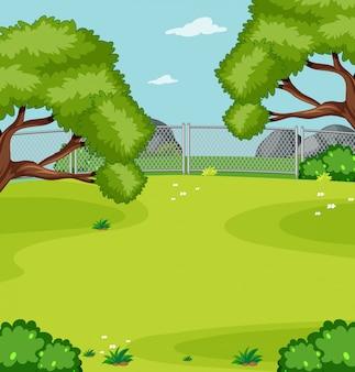 Pusta zielona łąka w parkowej scenie