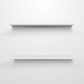 Puste białe półki na jasnoszarym tle.