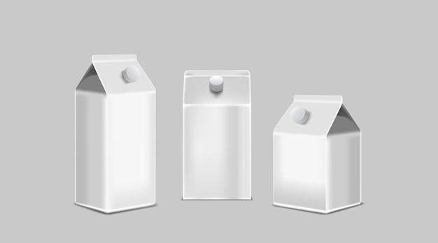 Puste białe pudełka kartonowe na sok lub mleko na białym tle