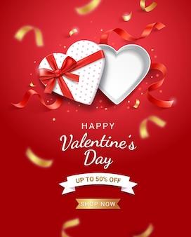 Puste białe pudełko w kształcie serca z czerwoną wstążką.