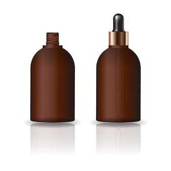 Puste brązowe okrągłe butelki kosmetyczne z pokrywką zakraplacz.