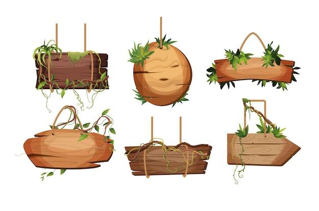 Puste drewniane deski wiszące na linach z gałązkami lian i tropikalnymi liśćmi zestaw vintage retro