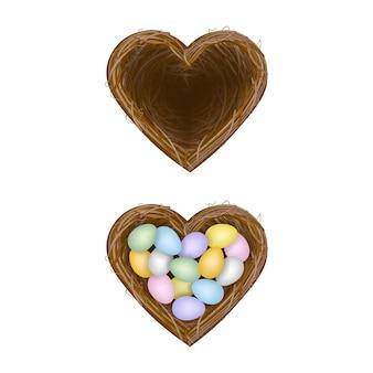 Puste gniazdo i gniazdo z kolorowymi jajkami