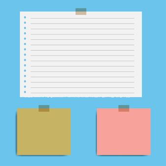 Puste kwadratowe strony notatnika i taśma klejąca