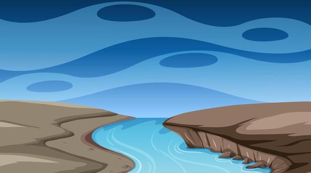 Puste niebo w nocnej scenie z rzeką płynącą przez ziemię