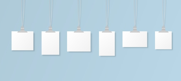 Puste wiszące ramki na zdjęcia lub szablony plakatów na tle. zestaw makiet białych plakatów zawieszonych na segregatorze na ścianie. ramka na kartkę papieru. ilustracja.
