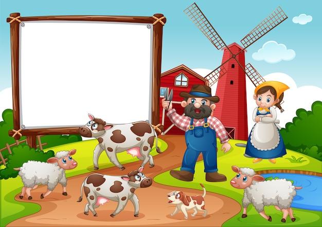 Pusty baner w gospodarstwie z czerwoną stodołą i wiatrakiem