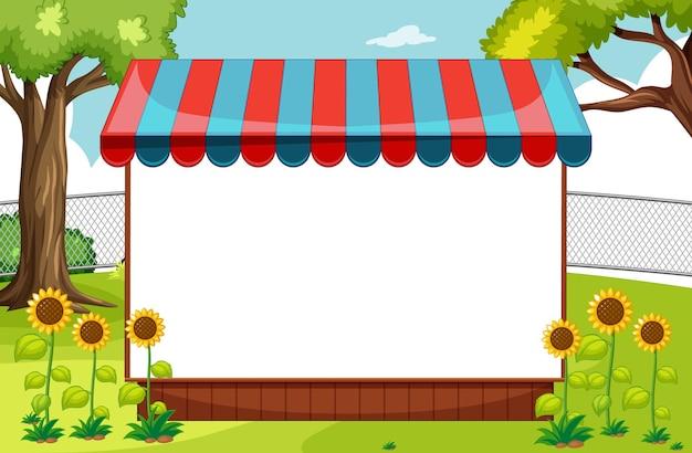 Pusty baner z markizą w scenie parku przyrody z słonecznikami