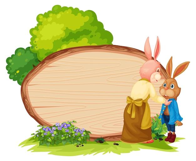 Pusty drewniany sztandar w ogrodzie z dwoma królikami na białym tle