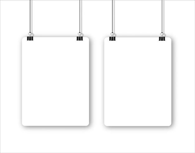 Pusty plakat wiszący na spinaczach do segregatora biała kartka papieru wisi na linie z spinaczami