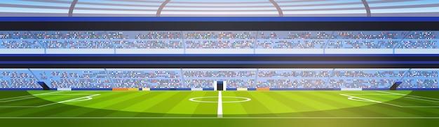 Pusty stadion piłkarski pole widok zachód słońca