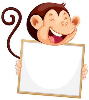 Pusty znak szablon z szczęśliwy małpa na białym tle