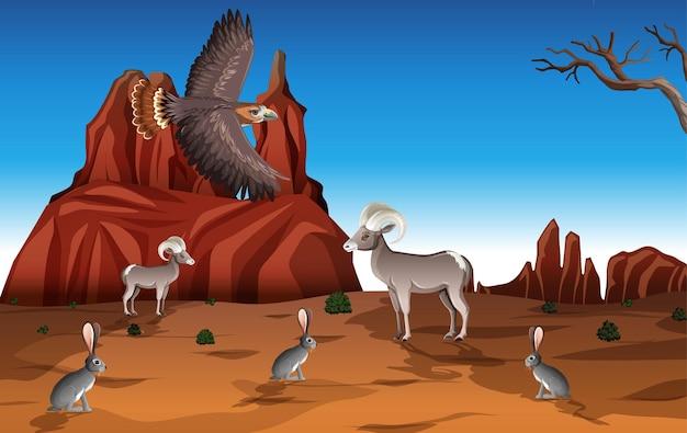 Pustynia z górami skalnymi i krajobrazem zwierząt pustynnych w scenie dnia