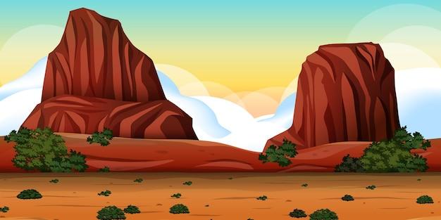 Pustynia z krajobrazem gór skalnych w scenie dnia