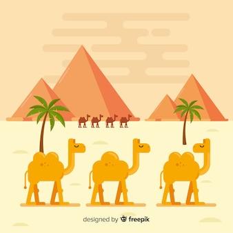 Pustynny krajobraz z piramidami i karawaną