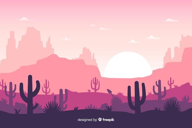 Pustynny krajobraz z różowym niebem i słońcem