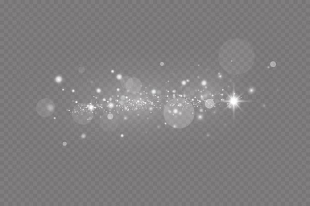 Pył iskry i gwiazdy świecą specjalnym światłem świątecznym efektem błyszczące drobinki