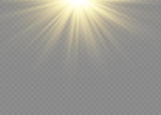 Pył iskry i złote gwiazdy świecą specjalnym światłem. błyszczy na przezroczystym tle. efekt świetlny. lśniące magiczne cząsteczki kurzu wewnątrz kolby