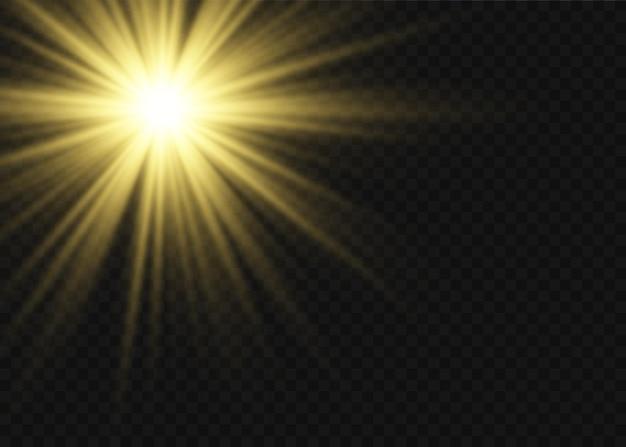 Pył iskry i złote gwiazdy świecą specjalnym światłem. błyszczy na przezroczystym tle. świąteczny efekt świetlny. lśniące magiczne cząsteczki kurzu wewnątrz kolby