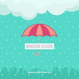 Rain w tle miasta i parasol